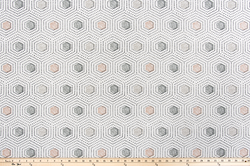 Photo of grey and pink repeating dotted pattern fabric