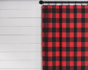 Picture of window curtains made with large red and black plaid pattern