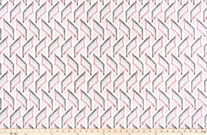 picture of modern repeating geometric grey and pink fabric