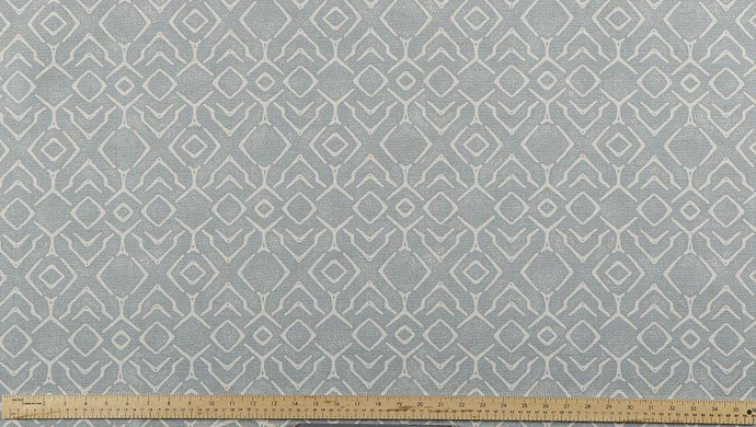 photo of blue fabric with a printed repeating diamond pattern modern farmhouse inspired