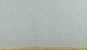 photo of blue and grey fabric with a printed repeating diamond pattern modern farmhouse inspired