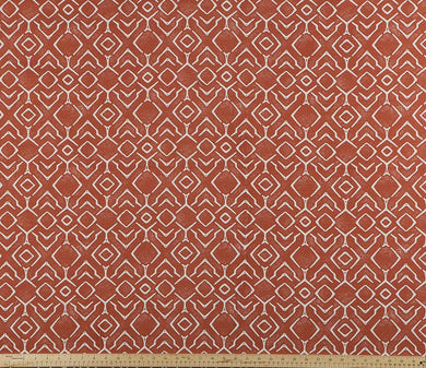 photo of orange and white fabric with a printed repeating diamond pattern modern farmhouse inspired