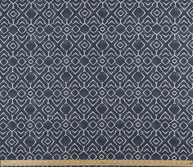 photo of blue and white fabric with a printed repeating diamond pattern modern farmhouse inspired