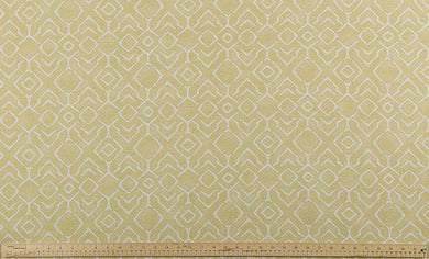 photo of yellow and white fabric with a printed repeating diamond pattern modern farmhouse inspired