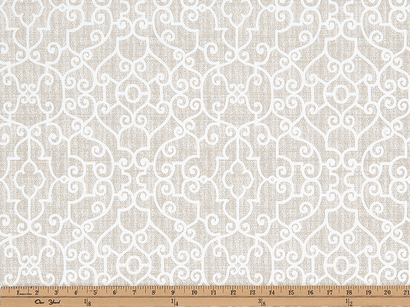 Photo of tan elegant geometric scroll design pattern printed on white fabric