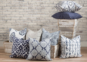 picture of pillows made with white and navy blue luxury fabric in wooden barn farm troth