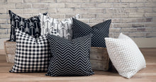 picture of pillows made with white and black luxury fabric in wooden barn farm troth