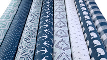 picture of nautical themed fabric bolts