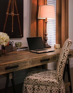 Picture of office decorated with brown chevron and tribal pattern fabrics