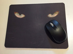 Printed mouse pad with cat eyes, panther eyes.