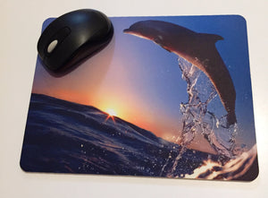 Printed mouse pad with a dolphin.