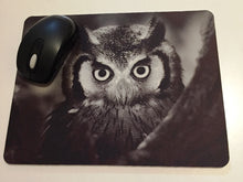 Printed mouse pad with an owl.