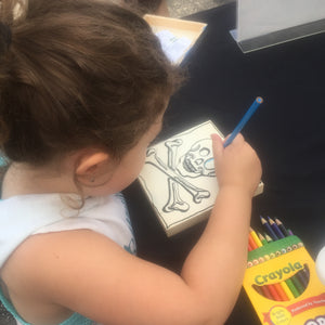 Little girl coloring at craft fair