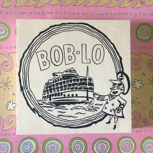 Unfinished Bob-Lo NicheBoard flat on patterned background