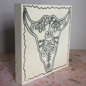 Free standing unfinished bull sugar skull on angle to show depth of product