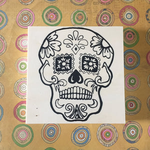 Unfinished Sugar Skull flat lay on patterned background