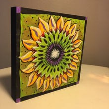 Free standing finished sample Sunflower Nicheboard on angle to show depth of product, yellow, green, black violet
