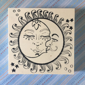 Unfinished Sun Moon NicheBoard flat on patterned background ready to be painted or colored