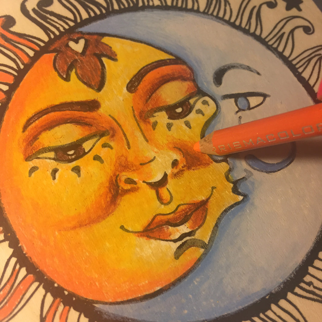 Close-up Sun and Moon NicheBoard in progress artist working with colored pencil