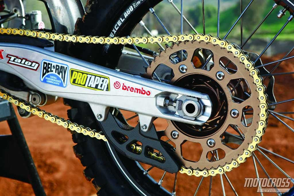 close up of beautiful and clean rear swing arm sprocket and chain pic from Motocross Action Mag
