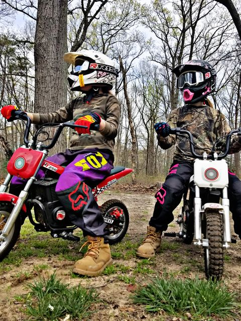 close up of two very young dirt bike riders on their bikes both wearing Risk Racing Goggles