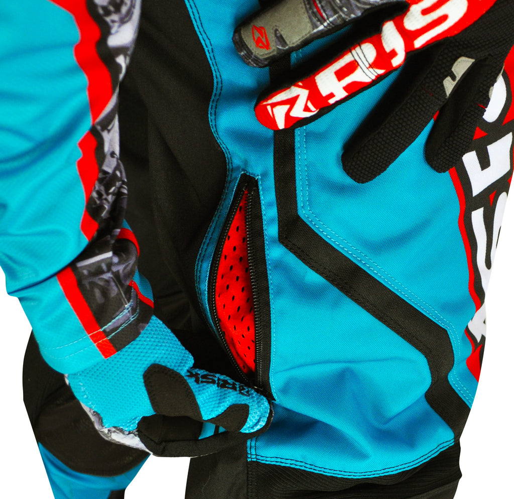 extreme close up person wearing all blue and orange risk racing gear showing off vents in mx pants
