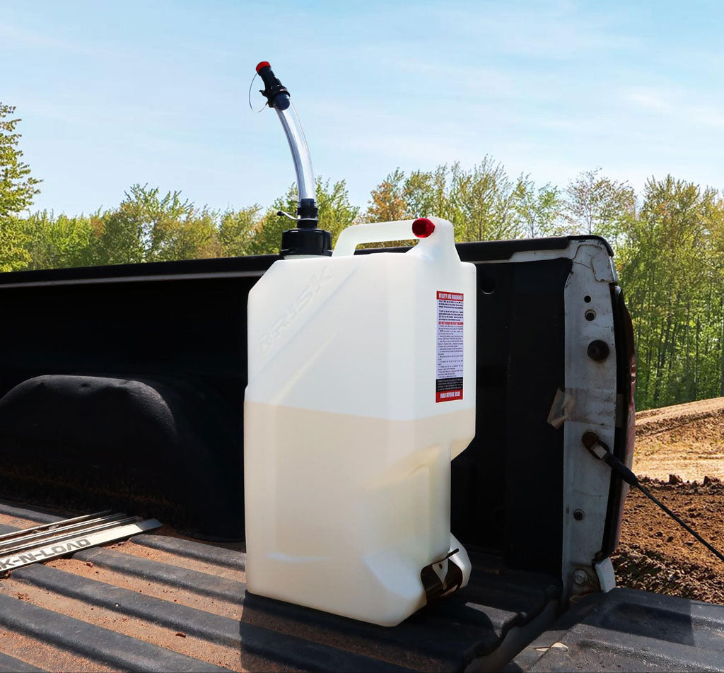 ez 3 or 5 gallon utility jug with hose bender spout by risk racing mounted in the back of a pickup truck