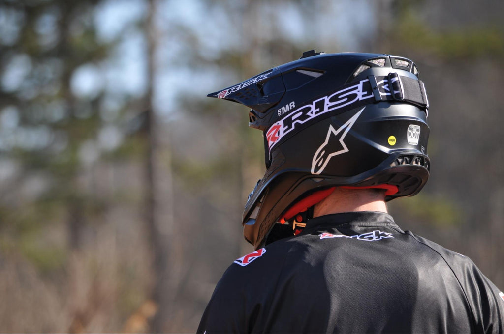 motocross rider wearing black Risk Racing jersey a star helmet and JAC Goggles by RR