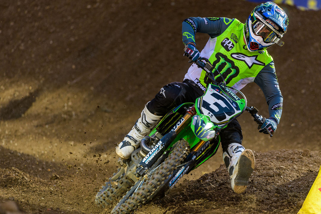 mx number 3 Kawasaki leaning into a turn on the track