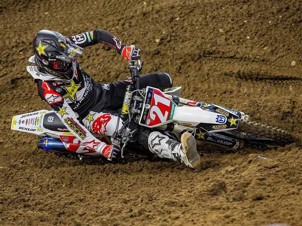 motocross number 21 leaning into a turn extremely hard almost completely horizontal