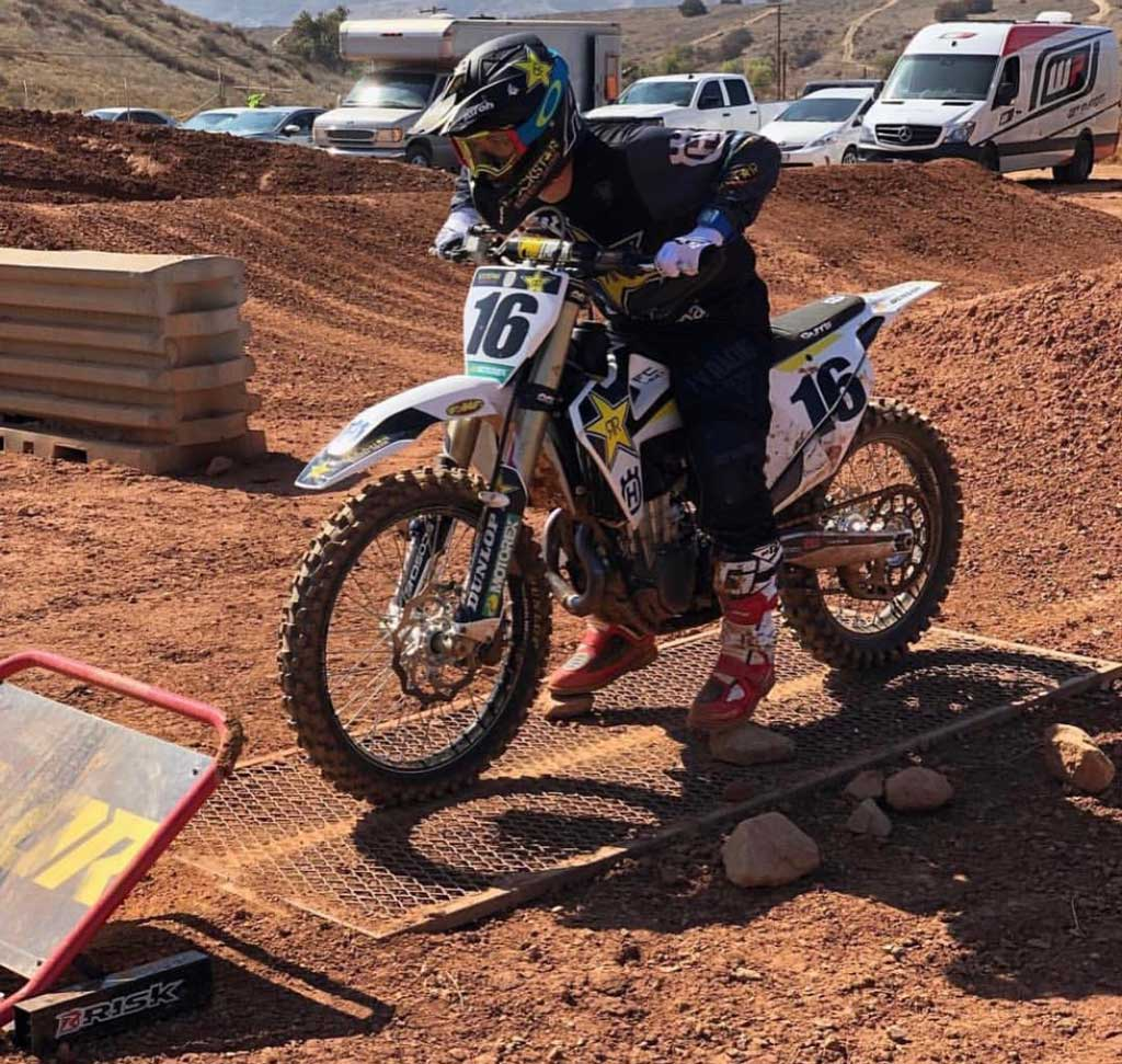 num 16 awaiting a gate drop while practicing his take offs using a holeshot gate by risk racing