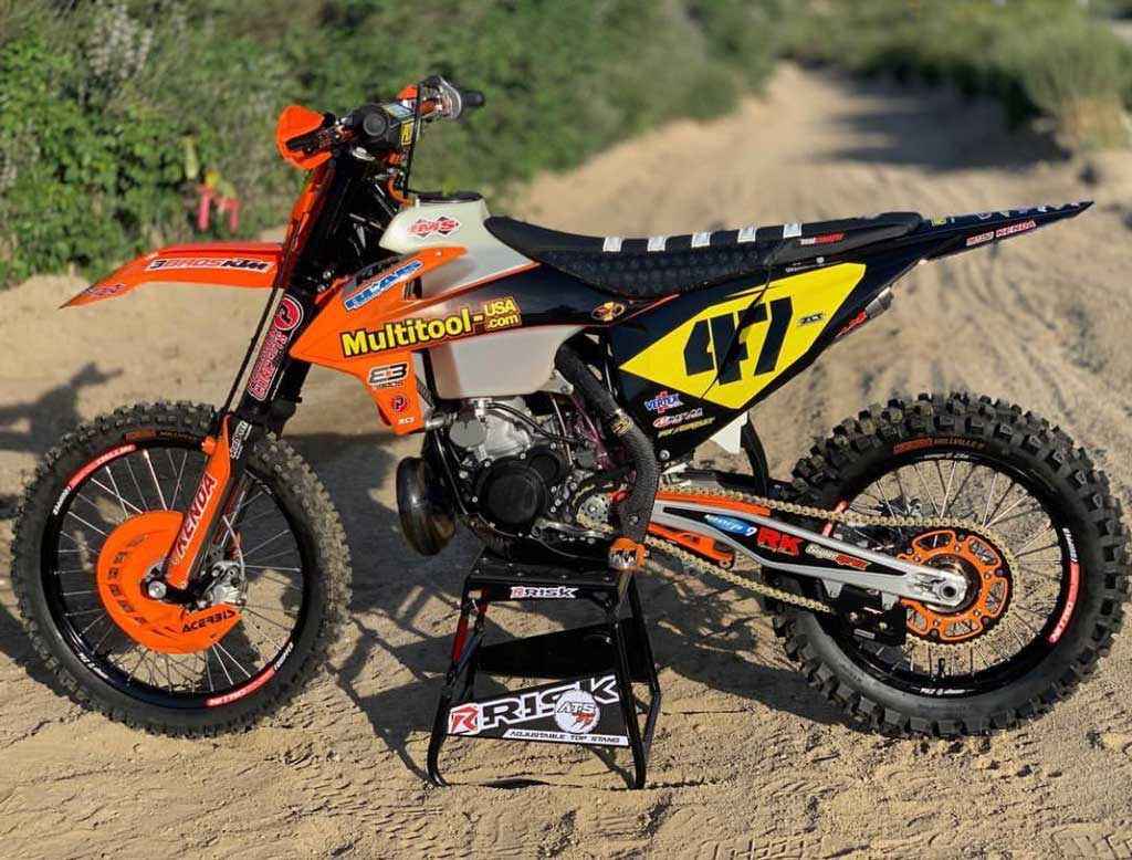 num 47 ktm multitool usa motocross sponsored dirt bike sitting on an ATS stand by Risk Racing