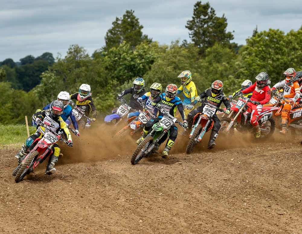 pack of mx riders 365-76-57-60-15-18 twelve plus all turning together on an outdoor track
