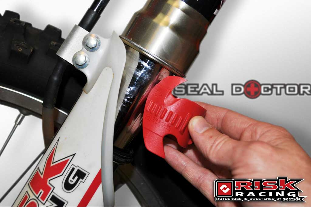 seal doctor in action going onto dirt bike forks with logo and branding
