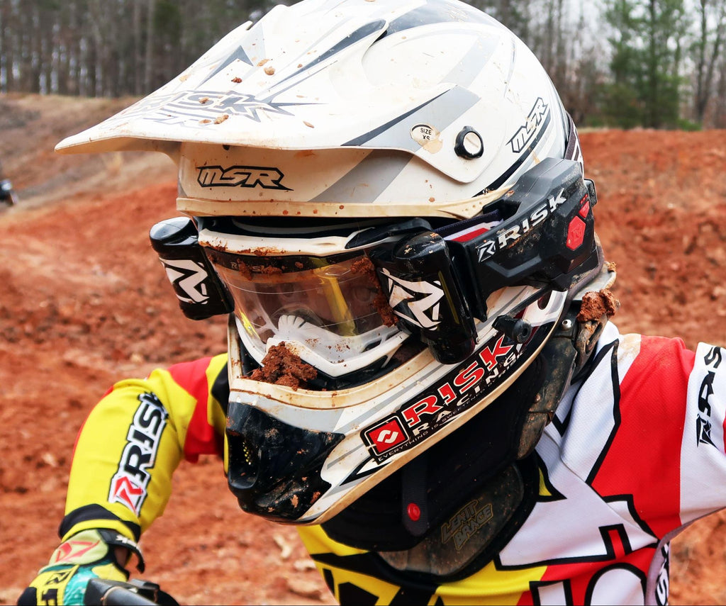 super close up on mx 77 Mike Burrys helmet setup inc Risk Racings JAC goggles and the Ripper auto roll off system