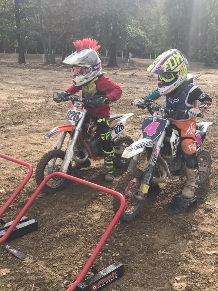 two peewee racers 026 n 4 lined up for a moto start at 2 risk racing holeshot starting gates