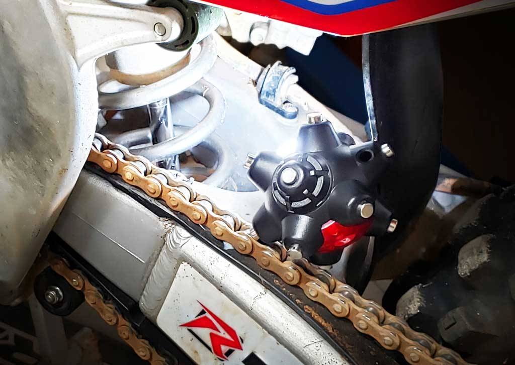 well lit dirt bike suspension rear swing arm area using a Magnetic light mine pro from STKR Concepts
