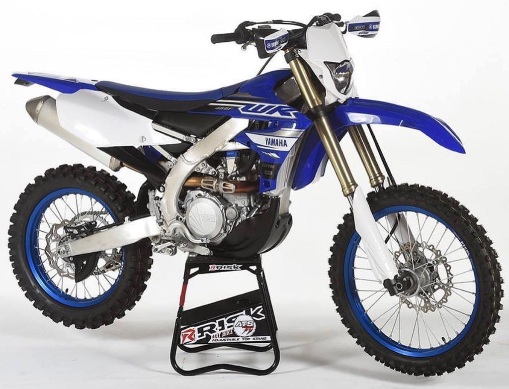 yamaha wr450f sitting on an ATS adjustable top motocross stand by Risk Racing white studio bg