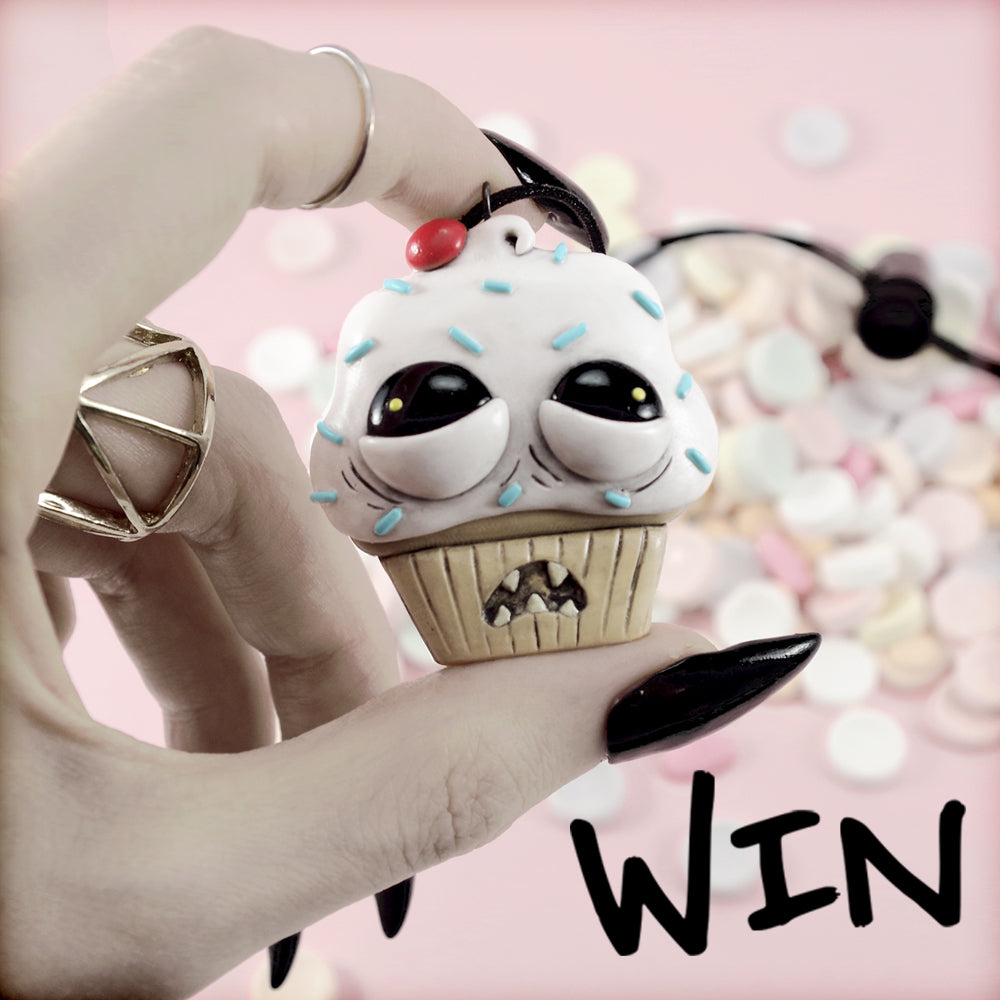 Win the ugly cupcake necklace