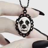 sad clown necklace