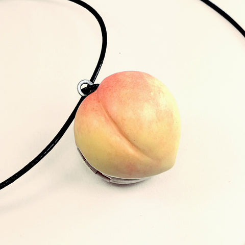 an orange and coral peach handmade from polymer clay