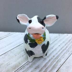 Ceramic Cow with Flower and Leaf Wreath