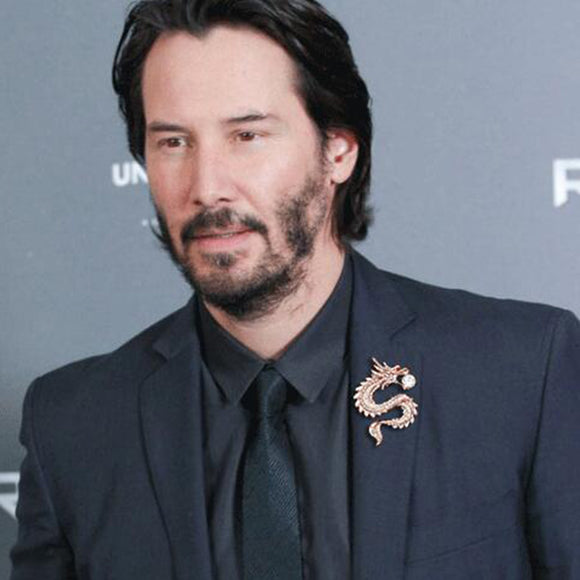 Famous Actor Keanu Reeves Wearing Nice Looking Dragon Brooch on his Suit.
