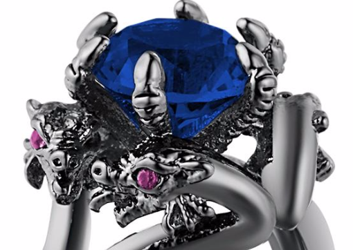 In this close up view you can see the dragon heads and the claw.  You also see how pretty this dragon ring is!
