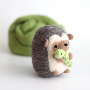 Needle Felted Hedgehog holding Worm by Wild Whimsy Woolies