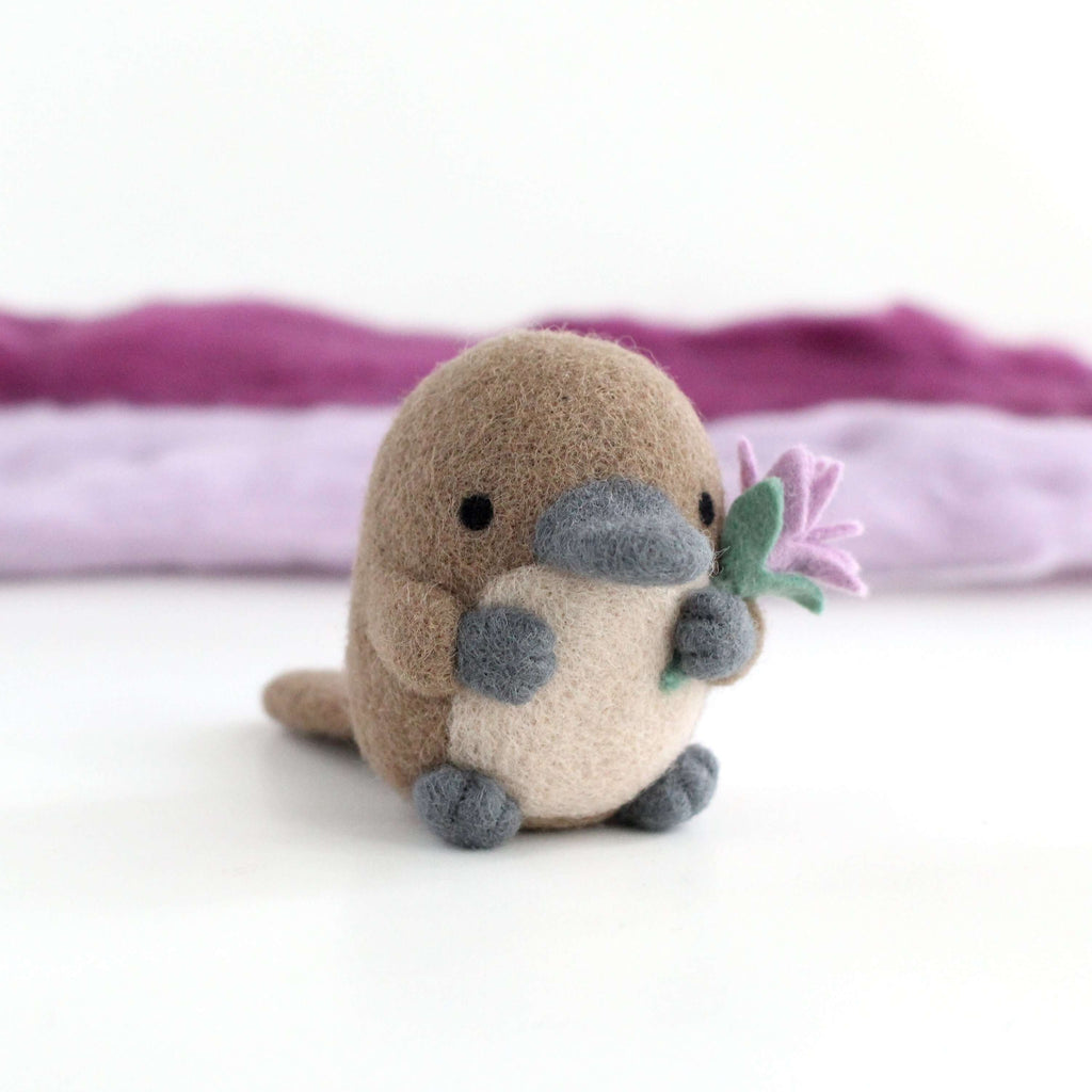 Needle Felted Platypus holding a Wildflower (Light purple) by Wild Whimsy Woolies