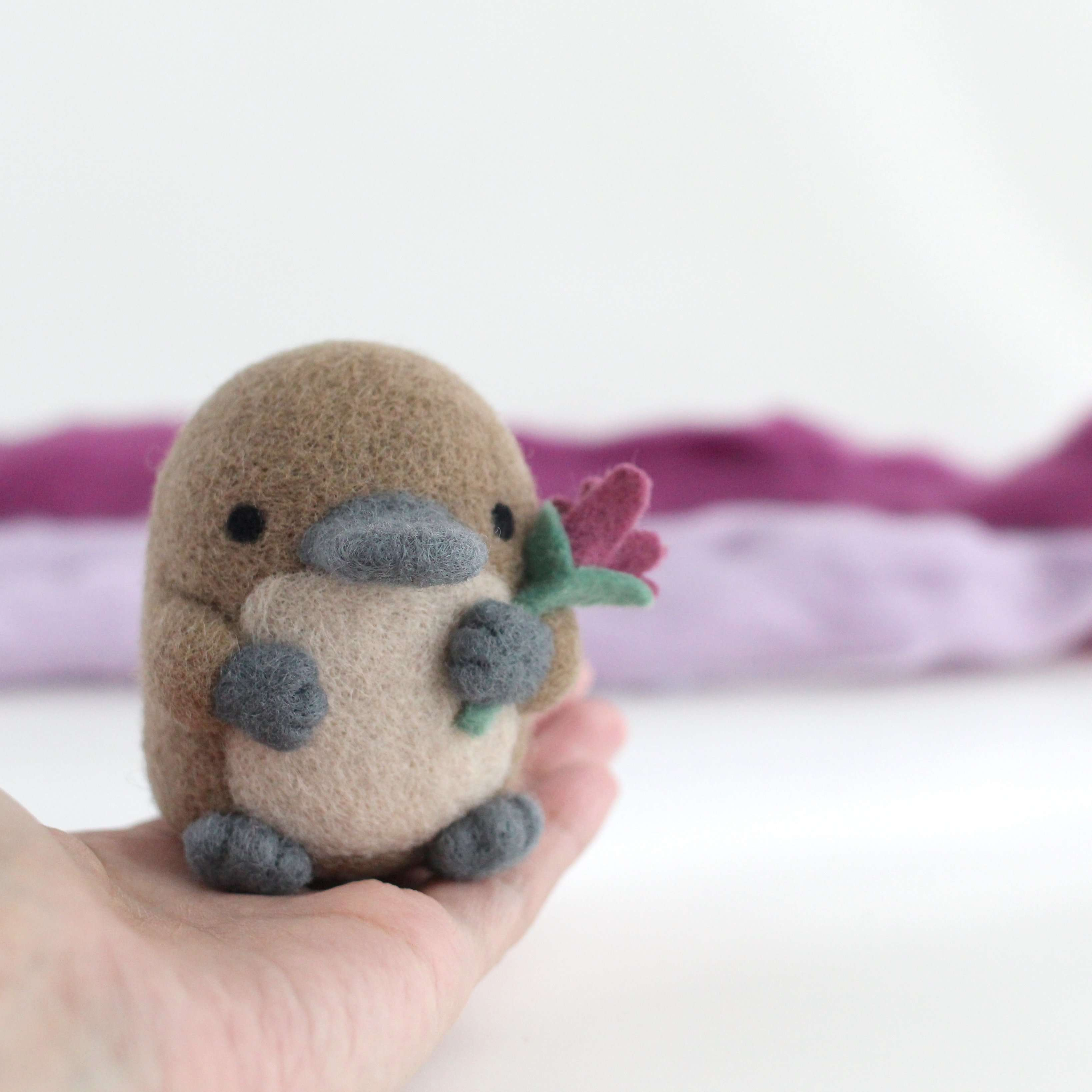 Needle Felted Platypus holding a Wildflower (Magenta) by Wild Whimsy Woolies