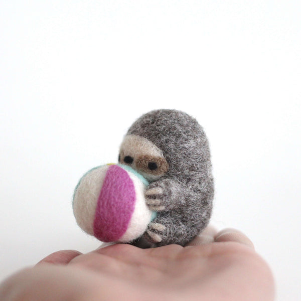Needle Felted Sloth Holding a Beach Ball Keychain by Wild Whimsy Woolies