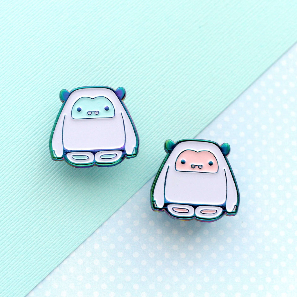 Yeti Enamel Pins (Rainbow Metal/Pink and Blue Variants) - Enamel Pin Set of 2 by Wild Whimsy Woolies