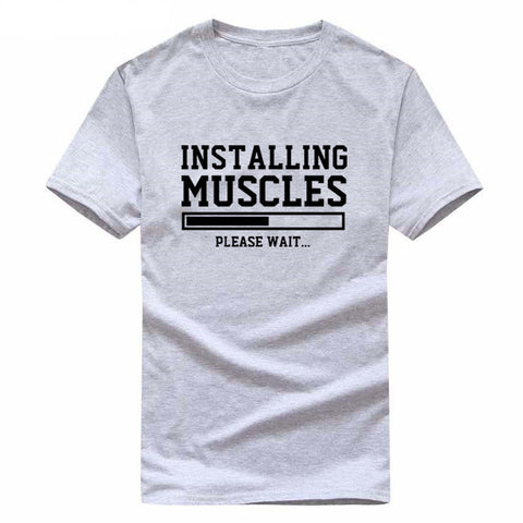 INSTALLING MUSCLES funny Tee Unisex